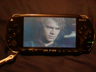 Yes, that IS a PSP with the Star Wars Episode 3 trailer